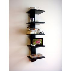 Store your books easily with these Spine Wall book shelves. The vertical design of this five-shelf unit makes it easy to display your favorite books, picture frames and other collectibles without sacr Glass Wall Shelves, Wall Shelf Decor, Floating Shelves Diy, Wall Mounted Shelves, L Shaped Shelves, Wall Bookshelves, Book Shelves, Diy Corner Shelf, Wall Racks