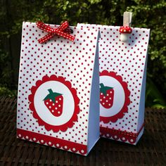 DIY favor bags with scrapbook paper and ribbon. I can do this.