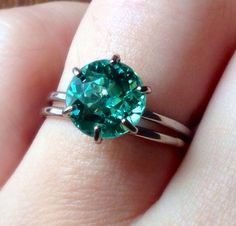 Paraiba Tourmaline Ring by RefinedRock on Etsy, $2200.00 I like simplicity in a ring...with a few small conflict-free diamond baguettes