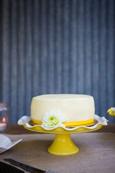 simple cake on a lovely yellow cake stand.
