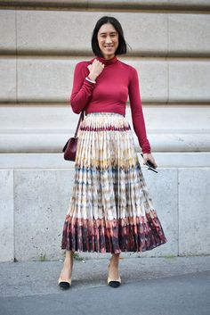 Eva Chen added a chic finish to her pleated maxi with hers.