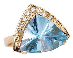 Topaz ring, 14 carat gold, topaz trillion framed by small round cut diamonds