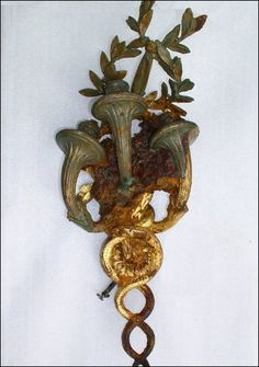 A gilded, Louis XVI-style wall sconce from the a la carte restaurant recovered from the wreck site.