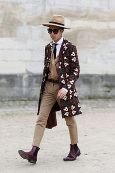 Menswear gets a 70's makeover on the streets of #PFW #AW15. WGSN Street Style Shot