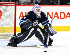 WINNIPEG, MB - NOVEMBER 13: Goaltender Michael Hutchinson #34 of the Winnipeg Jets takes part in the pre-game warm up prior to NHL action against the Los Angeles Kings at the MTS Centre on November 13, 2016 in Winnipeg, Manitoba, Canada. (Photo by Darcy Finley/NHLI via Getty Images)