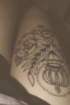 I like the clean lines of the crown over the diamond, with laurels and roses. Nice symbols, but not my choices...   ... and if it's on my thigh-top: i want it to be multi-directional!