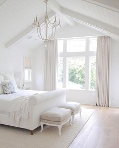 Neutral bedroom, tufted headboard , vaulted ceiling