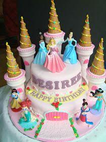 A 2-tier Disney Princess Castle fondant cake. The cake is light vanilla butter cake. Castle towers are edible.