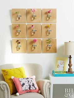 With dreamy photos of fresh flowers filling social media feeds everywhere, it's only natural to crave a bouquet or two for your own home. Rather than splurging on big bunches of live blooms, try picking up one small handful of cut stems from the supermarket, and spread them across multiple glass vases. When hung in wooden wall-mounted plaques like this DIY craft, you can make your modest flower budget go further.