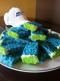 Seahawks colored rice krispy treats, dipped in white chocolate and sprinkles.