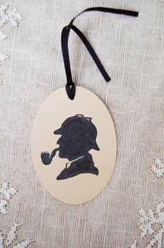 Sherlock Holmes Large Oval Gift Tags Set of 6 by PaperThyme, $4.50. Mystery party favors