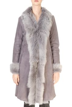 This is'London' Grey Toscana Sheepskin Coat by British designer 'Dom Goor'. Add a decadent and sophisticated addition to your outerwear...