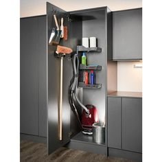 Kitchen Organisers to keep your tall cleaning cupboard tidy; this handy holder stores your vacuum hose, vac bags, and ironing board efficiently