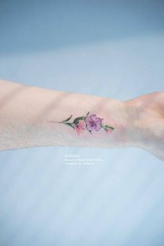 Small flower tattoo on the wrist. Tattoo artist: Sol Tattoo