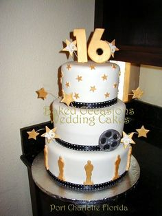 Sweet 16 Hollywood Style - This cake is white fondant with black ribbon made to look like movie film. Oscars, stars and film reel are made fondant with Tylose.
