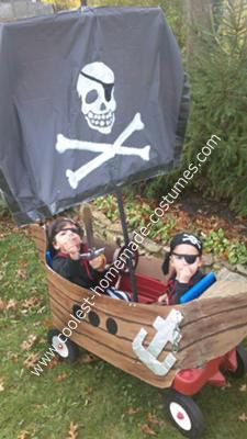 Homemade Pirate Ship Costume: Our 3 year old decided he wanted to be a pirate for Halloween, so we bought both him and his 1 year old younger brother, Andre, pirate costumes.  Since