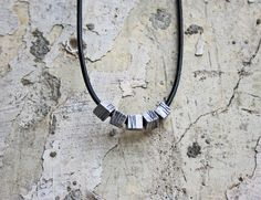 Silver necklace created by Paniquò. Lost wax casting.