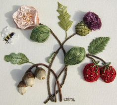 Stumpwork - This type of embroidery consists of creating shapes with felt and then stitching around the object for a 3D effect or adding a slight amount of fiberfill behind the object to make it stand out. This is beautiful!