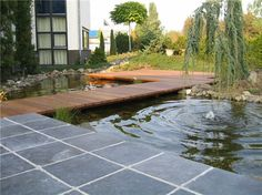 Decking with pond design by Guy Wolfs