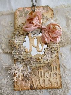 Paula Cheney: Sizzix Alterations Holiday Wreath tag http://ellenhutson.typepad.com/the_classroom_new/2012/12/12-tags-of-christmas-with-a-feminine-twist-2012-day-9-by-paula-cheney.html