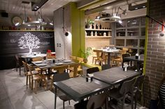 Just look at the tabletops from Java Island and luminous stones on ceilings, restrained minimalism and an unusual play of contrasts East Restaurant, Studios Architecture, Thessaloniki, Retail Shop, Commercial Interiors, Coffee Shop, Minimalism, Greece, Table