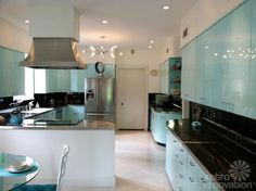 vintage-steel-kitchen-cabinets- Awesome house and kitchen renovation saving the original cabinets.