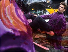 Spanish model Jon Kortajarena wears a purple and black look from Versace.