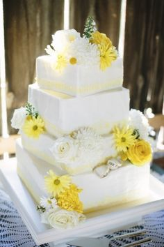 square tiered white cake with white and yellow daisies and roses, photo by Dan Stewart Photography