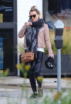 Hilary Duff Quilted Leather Bag - Hilary Duff accessorized her outfit with a quilted tan leather bag by Chanel.