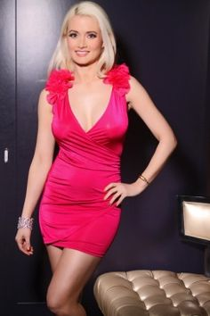 This stretch mini dress features plunge neckline, sleeveless, ruffled mesh shoulders detail, side ruchings.  $28.99