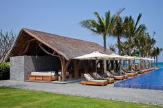 vo trong nghia's naman beach bar combines bamboo, thatch and stone