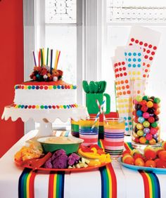 Love the rainbow ribbons on the white tablecloth and the cake.  WILLY WONKA THEME