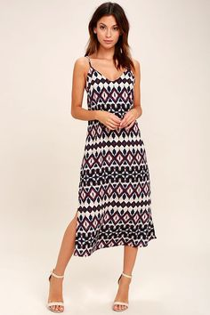 Sunsets and sandy beaches are what the Tahiti Sweetie Navy Blue and Beige Print Midi Dress is all about! Lightweight woven fabric is decorated in a navy blue, beige, and burgundy ikat print throughout a triangle shift bodice with spaghetti straps, and midi skirt with twin side slits. Row of button closures at back.