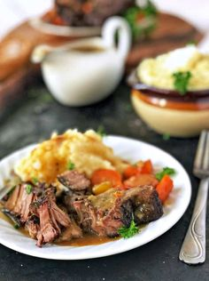 This oven-braised pot roast is melt-in-your-mouth tender, incredibly flavorful with veggies and fresh herbs, and super easy to put together!
