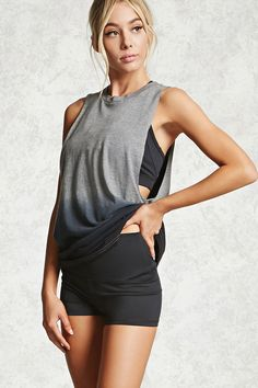 """A knit athletic muscle tee featuring an ombre dip-dye hem, a back """"17"""" jersey-block graphic, dropped arms, and a relaxed fit."""