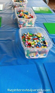 Lego activity table for a Lego themed birthday party for kids. Use Lego plates and buckets of Legos.