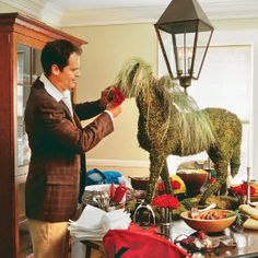 Moss horse centerpiece for Derby Party.  #Derby #Party