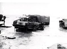 D-Day, Juno Beach - Equipment wrecked on the beach, D-Day landings. 6 June 1944, Bernieres-Sur-Mer, Normandy, France.