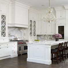 love it all! white kitchen & chandelier