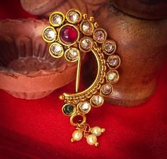 There are a lot of elegant designs available in the market. And now it's time to choose a traditional Nath collection for yourself that will enhance your beauty. Nath Nose Ring, Nose Ring Jewelry, Nose Rings, Diamond Jewellery, Jewlery, Jewelry Bracelets, Bangles, Maharashtrian Jewellery, Indian Nose Ring