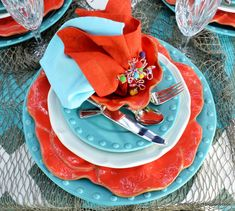 Turquoise and coral outdoor table setting with a beach vibe