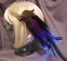 Glowing feather hair clip. A unique gift for the girl that loves to dress up. This fantasy accessory is onsale! #glowing #onsale #unique #halloween #mardigras #musicfestival #funkyfashion #fantasy #accessory