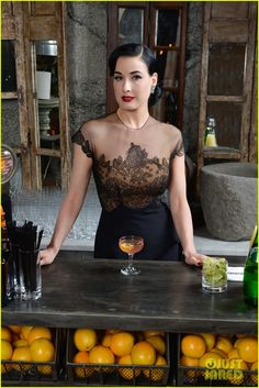 Dita promoting Cointreau. Love her sheer illusion dress. It appears to be vintage late 1930 early 40s.