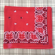 This is a Tiger brand vintage bandana made of Wash Fast Colors cotton with a beautiful three color print. WPL 9939. Machine stitched hem with a selvage on the bottom edge. Vibrant red with a few spots that look like possibly bleach spots. What a great piece of vintage work wear Americana. Measures approx. 22 x 19