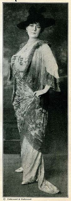 1915 Betty Nansen, the great Danish actress while she was in Hollywood, in her 'golden gown', the last one made by Paul Poiret before he went to the front to fight for France in WW1. The tunic is of cloth of gold stiffened with brocade and is so heavily embroidered with seed pearls and tiny diamonds that it weighs 32 pounds. The rest of the gown is old rose silk also hand embroidered.