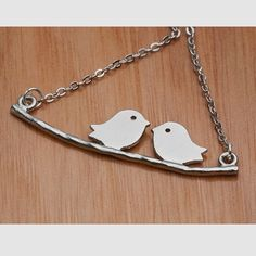 Two little birds on a branch necklace