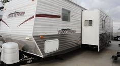34ft - 2007 - Trailrunner Bunk House By Heartland - $13,995.00 If you have a big family and a half ton truck this is the bunk house travel trailer for you! With sleeping for up to 9 people the whole family will truly enjoy the vacation this summer! Call today to schedule your showing! 469-554-0440 When you call remember to ask for Bob Barker and lets make a DEAL! See BudgetRVsOfTexas.com