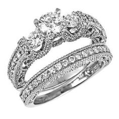 Diamond engagement ring and wedding band feature 14k white gold with 0.51ct natural round brilliant cut diamond center stone VS clarity, E color surrounded by 127 round diamonds 1.37ct VS clarity, F color in pave and channel settings. Width on the top is 8.1mm. Shank width is 5.7mm. Total weight is 1.88ct. AGI (Accredited Gemological Institute)