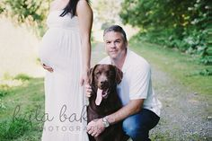 Love this shot with husband, belly and puppy, even the though mommy's face isn't showing!