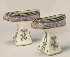 "ornamentedbeing:  Manchu women were forbidden by law to have their feet bound, as was the custom among Han Chinese women. In order to mimic the desirable ""lotus gait"" of the Han women, Manchu women added high platforms to their shoes that stilted their gait. This pair is beautifully embroidered with a peony motif.Manchu platformsChina, 19th centuryBSM P00.125  And this was how manchu women showed that their milkshakes also brought them boys to the yard."